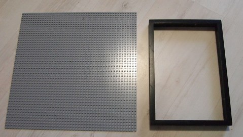 A large Lego baseplate and a Ribba frame.