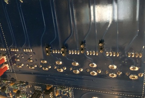 IC socket pins installed to PCB. The board traces are cut underneath the sockets.