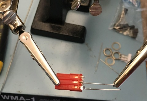Solder component feet to the pins..